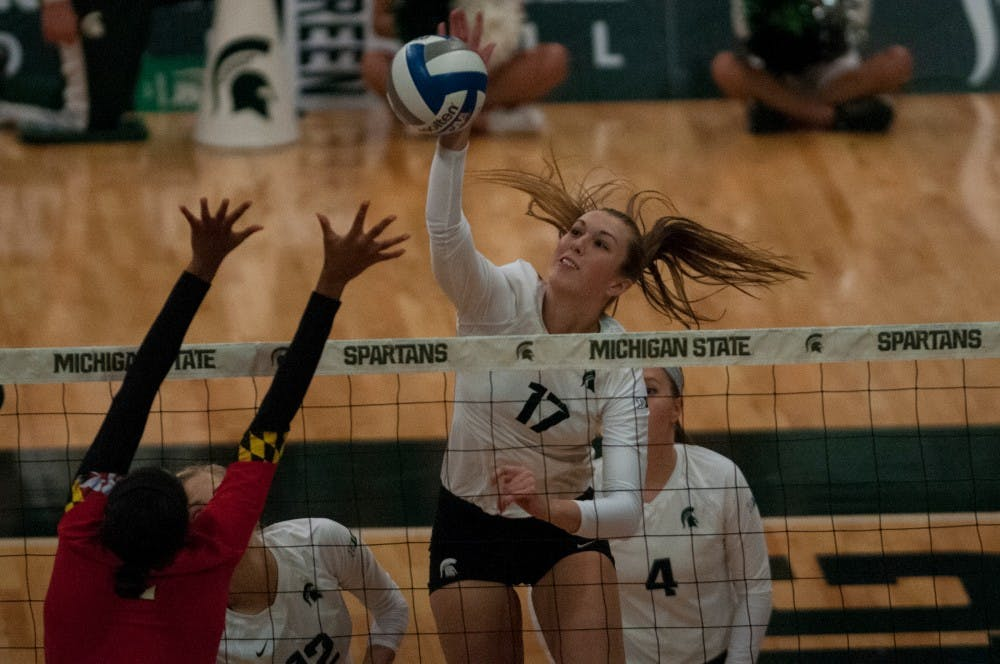 Junior middle blocker Alyssa Garvelink (17) spikes the ball during the game against Maryland on Oct. 8, 2016 at Jenison Field House.  The Spartans defeated the Terrapins, 3-1.