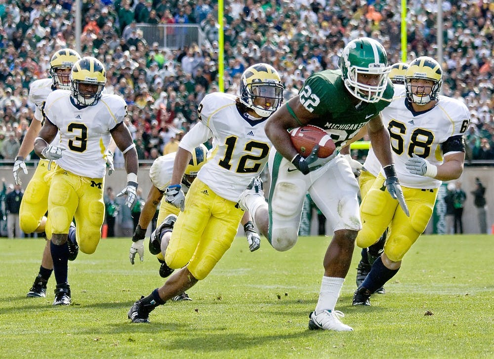 <p>Then-freshman running back Larry Caper rushes for a Spartan overtime victory, 26-20.</p>