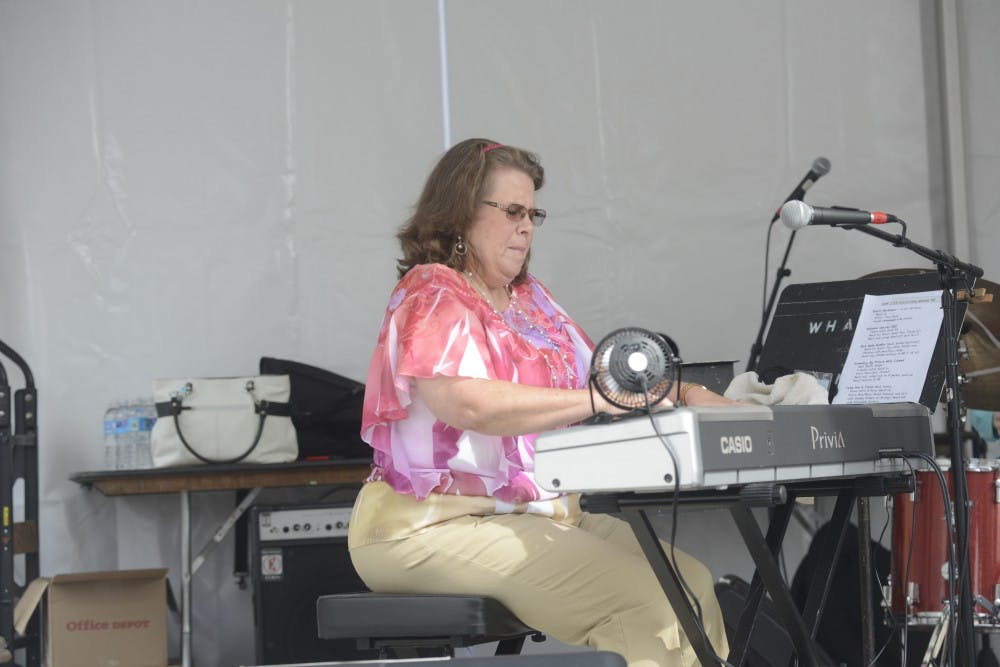 <p>Arlene McDaniel, an instructor of Jazz Piano at the Michigan State University Community Music School, plays piano as a part of the JAMM Scholarship Trio who work to create opportunities for young performers of Jazz during the East Lansing Summer Solstice Jazz Festival at Ann Street Plaza June 19th. 2015. Wyatt Giangrande/The State News</p>