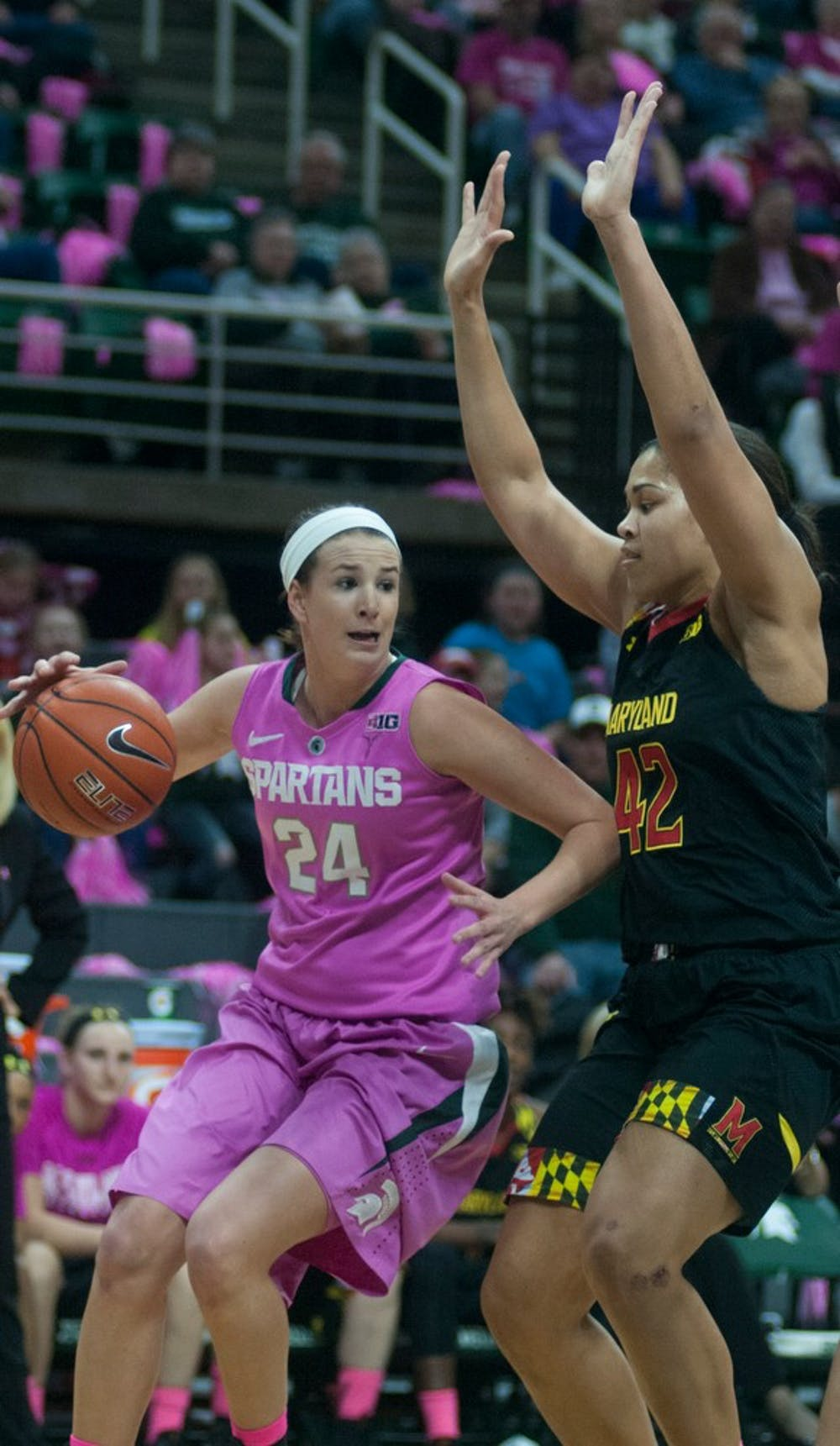 <p>Freshmen guard/forward Lexi Gussert gets around Maryland center Brionna Jones Feb. 16, 2015, during the Play4Kay Breast Cancer Awareness game against Maryland at Breslin Center. The Spartans were defeated by the Terrapins, 75-69. Hannah Levy/The State News</p>