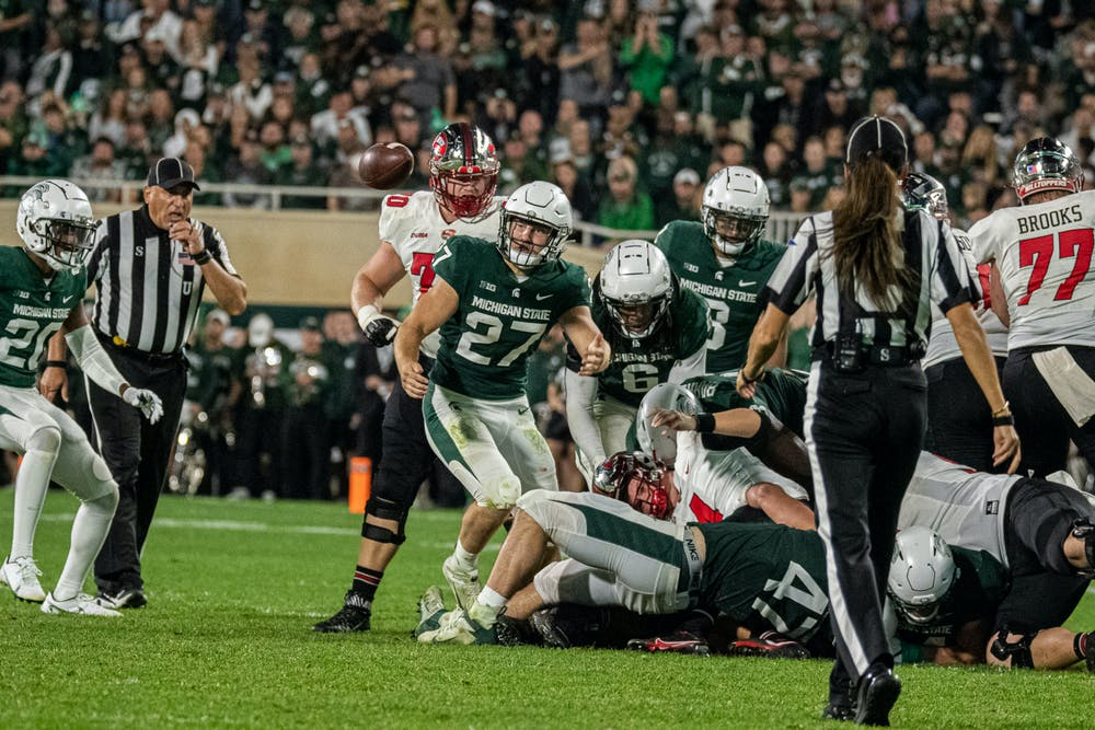 <p>A ball comes loose during the Spartans&#x27; 48-31 homecoming win against Western Kentucky on Oct. 2, 2021.</p>