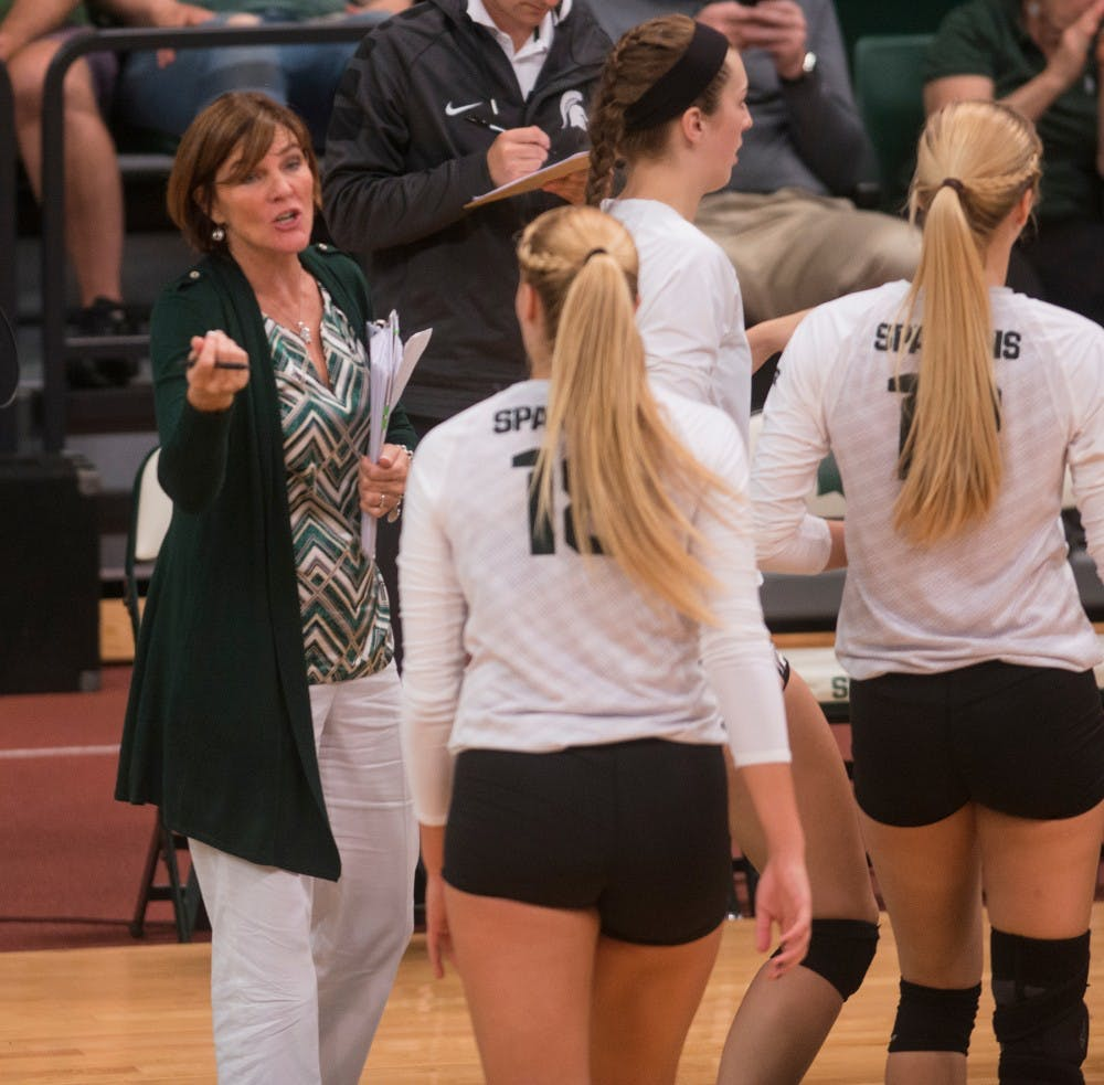 <p>MSU volleyball head coach Cathy George speaks with sophomore outside hitter Holly Toliver during the game against Indiana on Sept. 25, 2015 at Jenison Field House. The Spartans defeated the Hoosiers 3-0.&nbsp;</p>