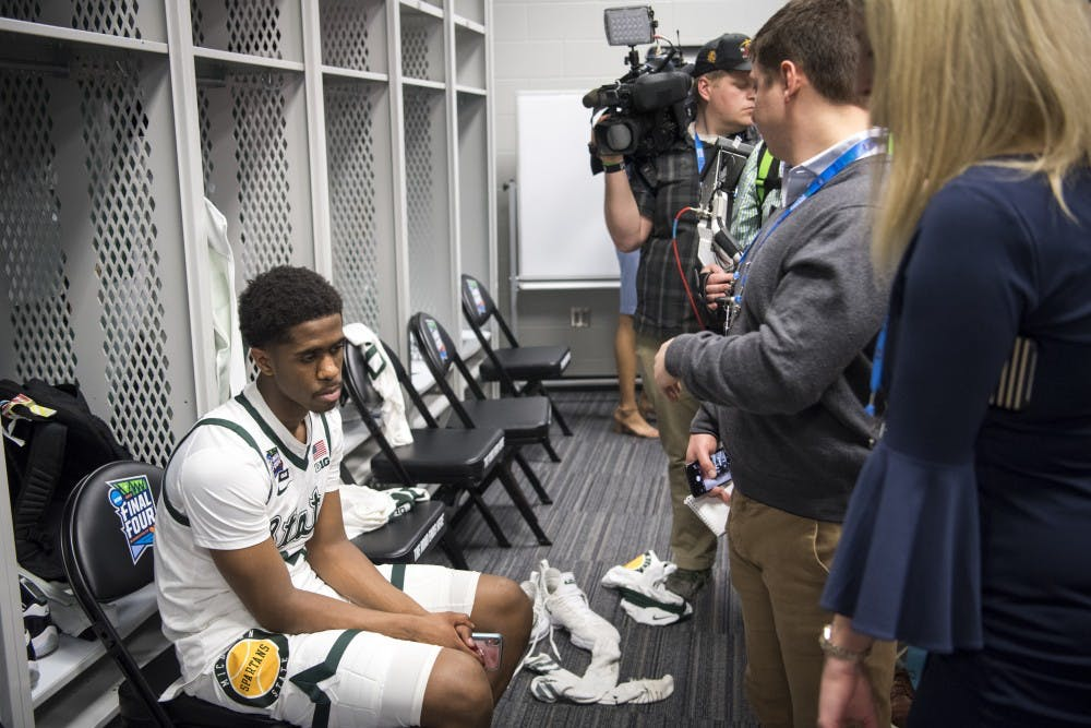 Freshman guard Brock Washington (14) looks on during post-game interviews of the NCAA Final Four game against Texas Tech at U.S. Bank Stadium in Minneapolis on April 6, 2019. The Spartans lost to the Red Raiders 61-51.  (Nic Antaya/The State News)