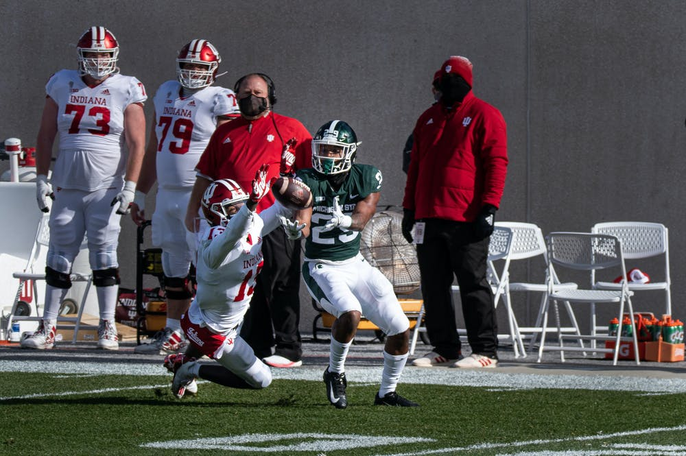 MSU cornerback, Shakur Brown (29), intercepts a Hoosier pass meant for Indiana wide receiver, Miles Marshal (13).