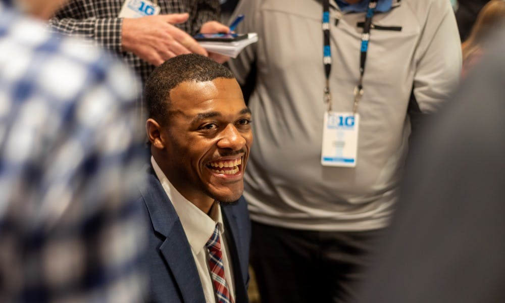 Junior forward Xavier Tillman laughs while being interviewed by the press during Big Ten basketball media day in Chicago on October 2, 2019.