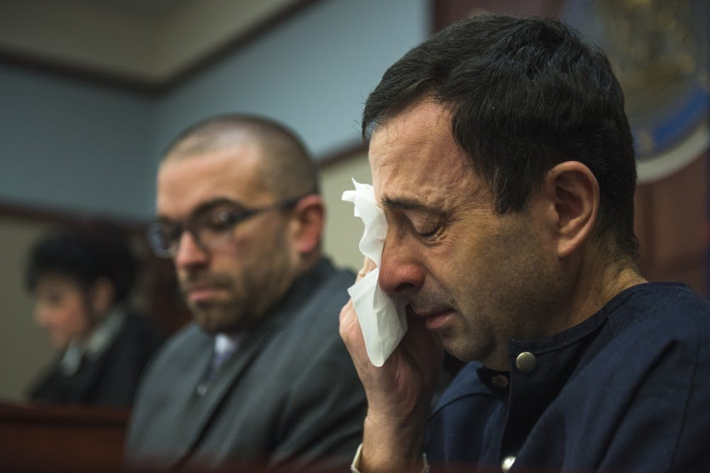 """<p>Ex-MSU and USA Gymnastics Dr. Larry Nassar tears up during Trenea Gonzcar's statement on the fourth day of his sentencing on Jan. 19, 2018 at the Ingham County Circuit Court in Lansing. Gonzcar said she has known him 31 of 37 years and that she defended Nassar until recently. """"It's time for me to stand up for these little girls and not stand behind you anymore Larry,"""" Gonzcar said. """"Good-bye Larry. May god bless your dark, broken soul."""" (Nic Antaya 