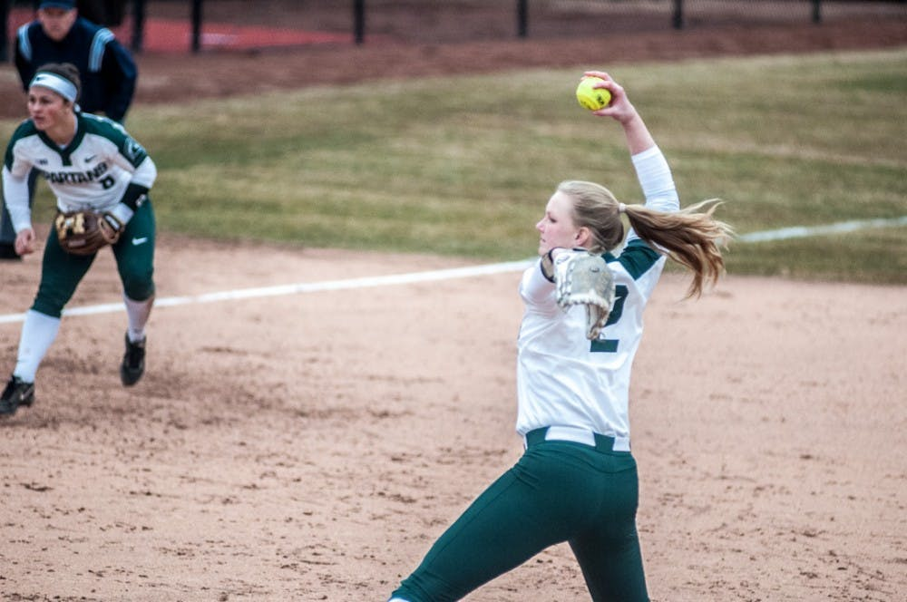 <p>Redshirt senior Kristina Zalewski (2) winds up to pitch the ball during the home opener game on March 28, 2018 at Secchia Stadium. The Spartans defeated the Broncos, 6-1. &nbsp;&nbsp;</p>