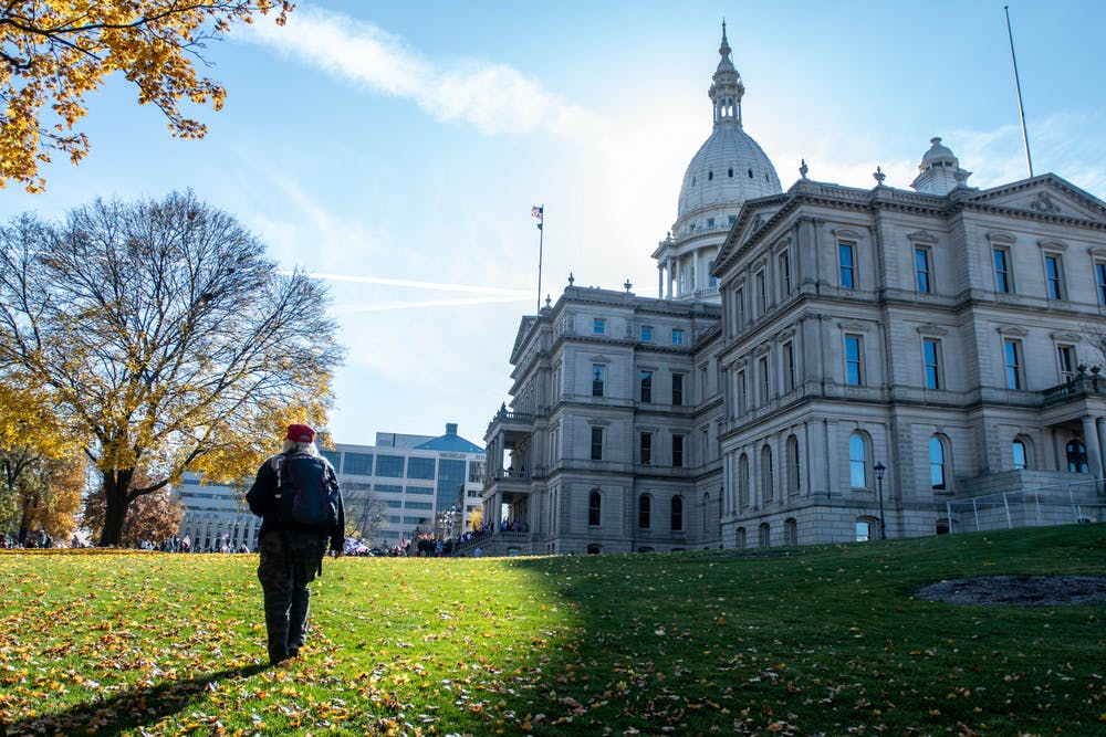 <p>Primarily Donald Trump supporters, but a few Joe Biden supporters, flocked to the Michigan State Capitol after Biden was deemed the winner of the 2020 presidential election on Nov. 7, 2020. People crowded the Capitol steps to listen to speakers.</p>