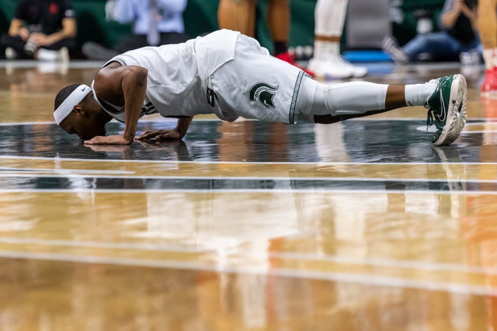 Senior guard Cassius Winston kisses the Spartan head at center court after being subbed out on his senior day. The Spartans defeated the Buckeyes, 80-69, at the Breslin Student Events Center on March 8, 2020.