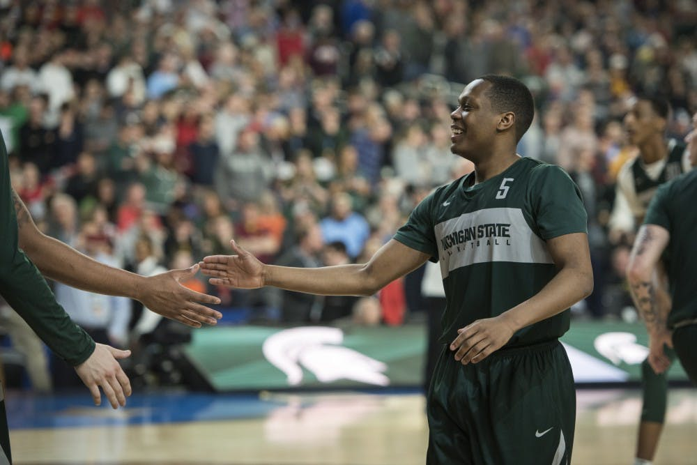 <p>Then junior guard Cassius Winston (5) slaps hands with then junior forward Nick Ward (44) during Michigan State&#x27;s NCAA Men&#x27;s Basketball Final Four open practice at U.S. Bank Stadium in Minneapolis on April 5, 2019. (Nic Antaya/The State News)</p>