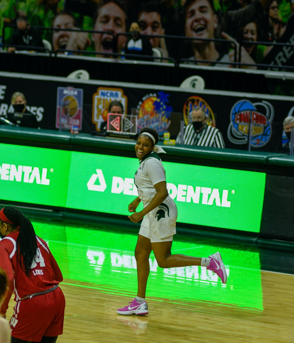 <p>Michigan State&#x27;s Janai Crooms (23) smiling while she ran down the court during the game against Wisconsin on Saturday, March 6, 2021.</p>