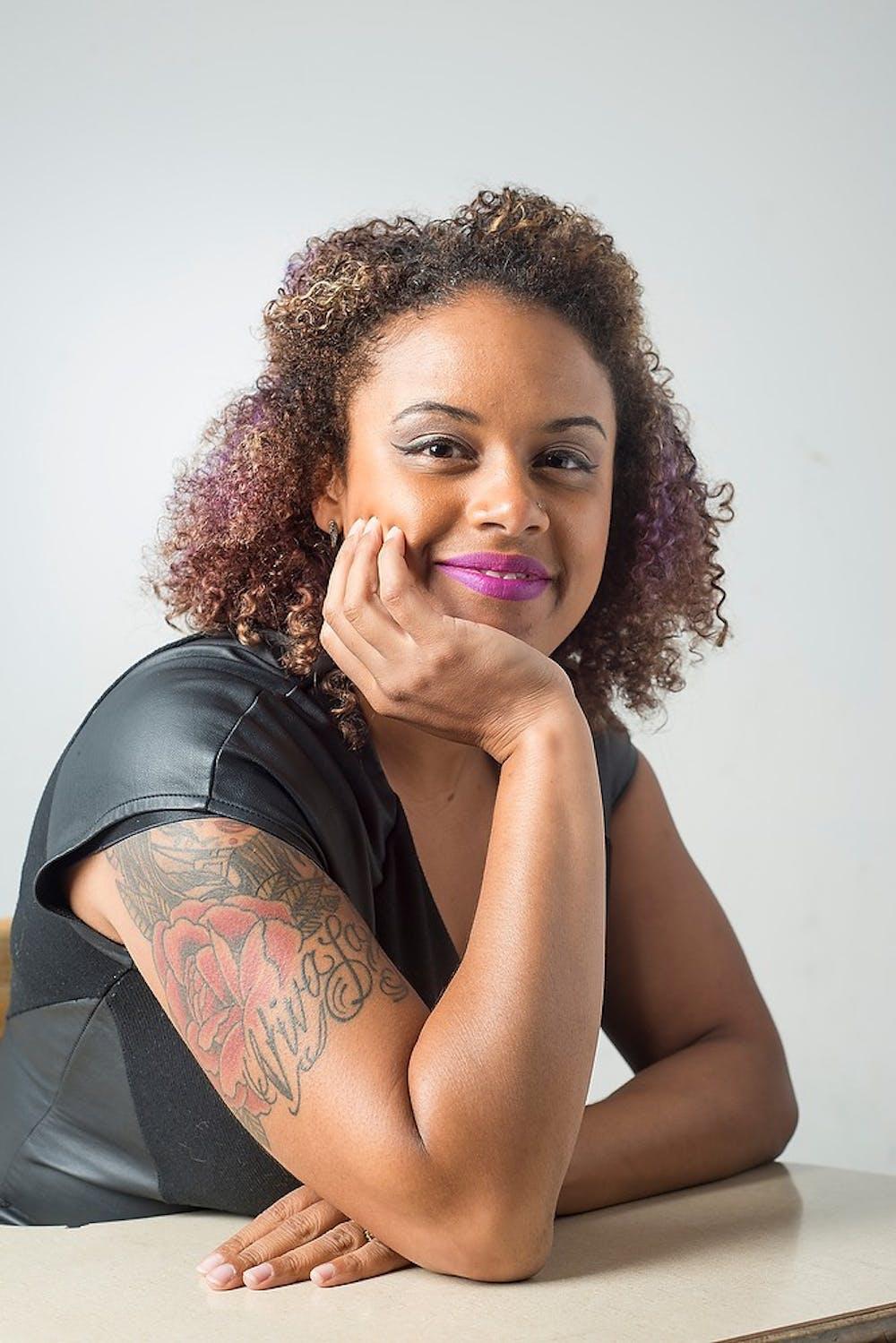 <p>Executive Director of The Firecracker Foundation Tashmica Torok poses for a portrait Sept. 10, 2014. Torok has six tattoos. Julia Nagy/The State News</p>