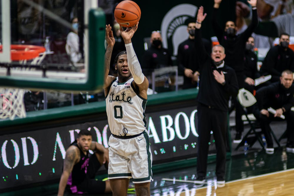 <p>Then-junior forward Aaron Henry puts up a mid-range shot. Henry&#x27;s 20 point night helped the Spartans&#x27; win against Penn State on Feb. 9, 2021.</p>