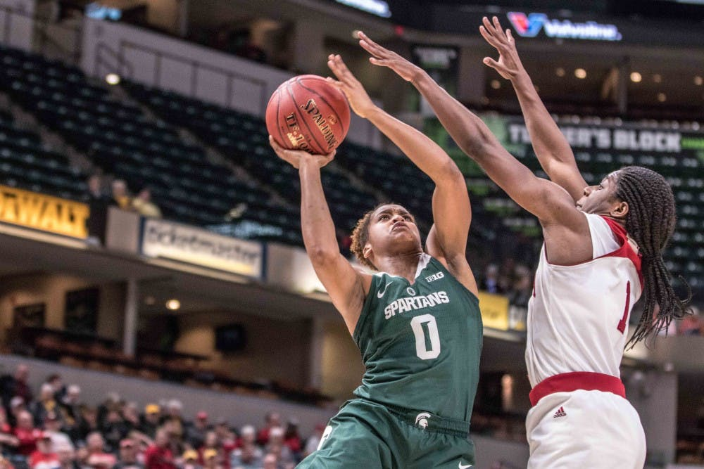Redshirt sophomore guard Shay Colley (0) shoots a contested layup during the game against Indiana on March 1, 2018, at Bankers Life Fieldhouse. The Spartans fell to the Hoosiers, 111-109, in 4OT.