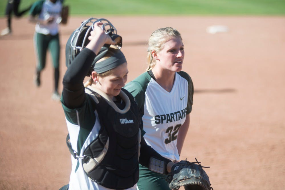 Sophomore Bridgette Rainey, right, and sophomore catcher Jordan Davis walk to the dugout during the game against Broncos on March 29, 2016 at Secchia Softball Stadium. The Spartans defeated the Western Broncos, 12-2.