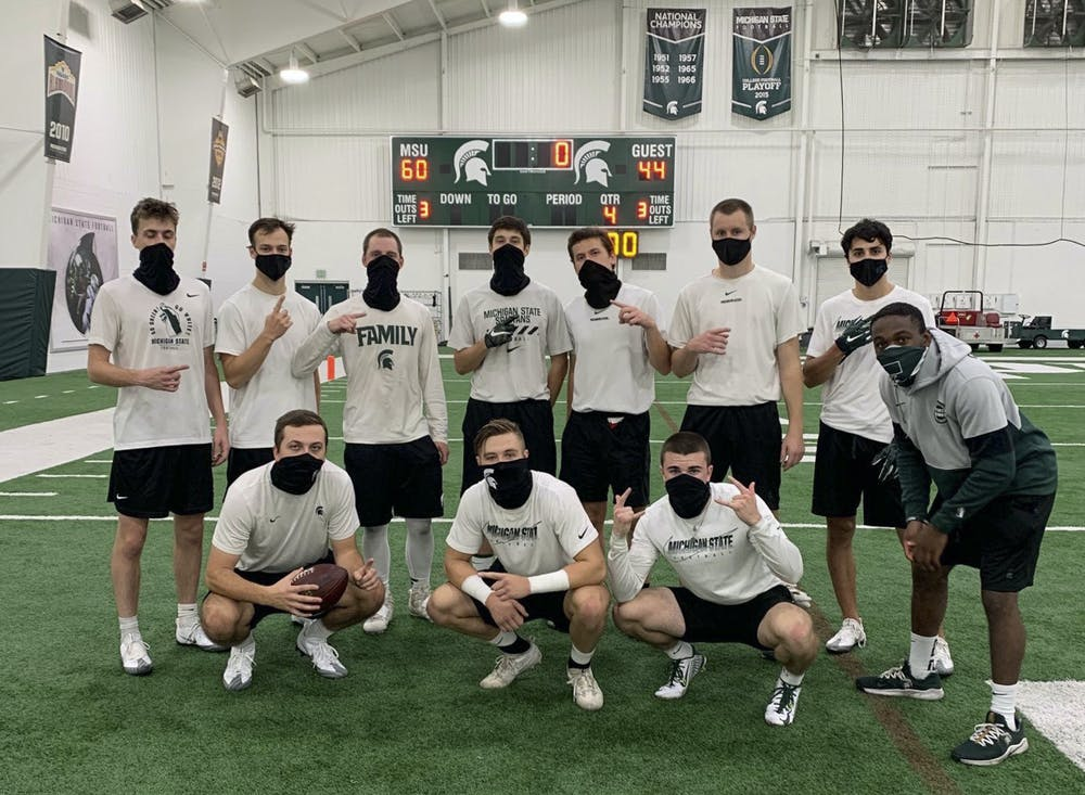 <p>Michigan State&#x27;s student equipment managers pose at the Skandalaris Football Center on the indoor practice field. </p><p></p><p>Pictured, back row (from left to right): Andrew Campbell, Michael Grodi, Dan Kalchik, Liam Ryan, Ben Connelly, Ryan Campbell, Nick Franz and Markael Butler. Front row (from left to right): Ryan Daugherty, Mason Ruddy and Casey Edwards. (Photo courtesy: Ryan Daugherty, Michigan State Class of 2022)</p>