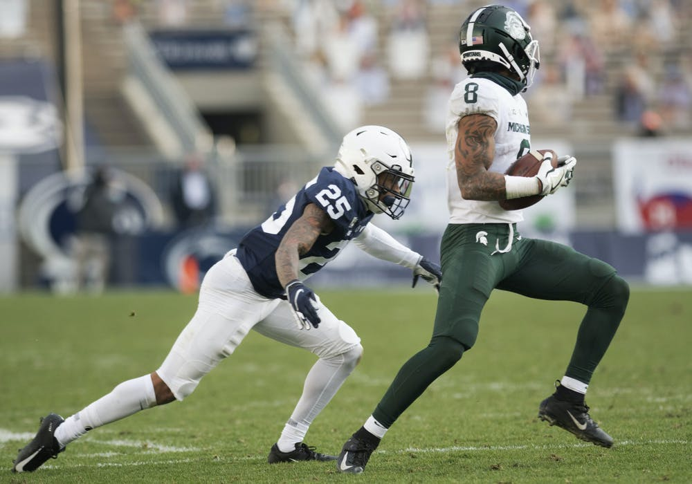 <p>Penn State cornerback Daequan Hardy (25) runs to tackle Michigan State's Jalen Nailor (8) during the game on Saturday, Dec. 12, 2020, in Beaver Stadium. Penn State won 39-24. Photos courtesy of Lily LaRegina, photographer and photo editor at The Daily Collegian.</p>