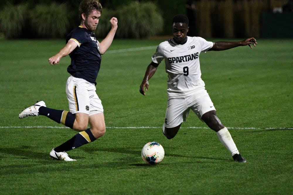 <p>Sophomore forward Farai Mutatu (9) steals the ball during the game at DeMartin Field on Sept. 24, 2019. The Spartans lost to the Fighting Irish 0-1. </p>