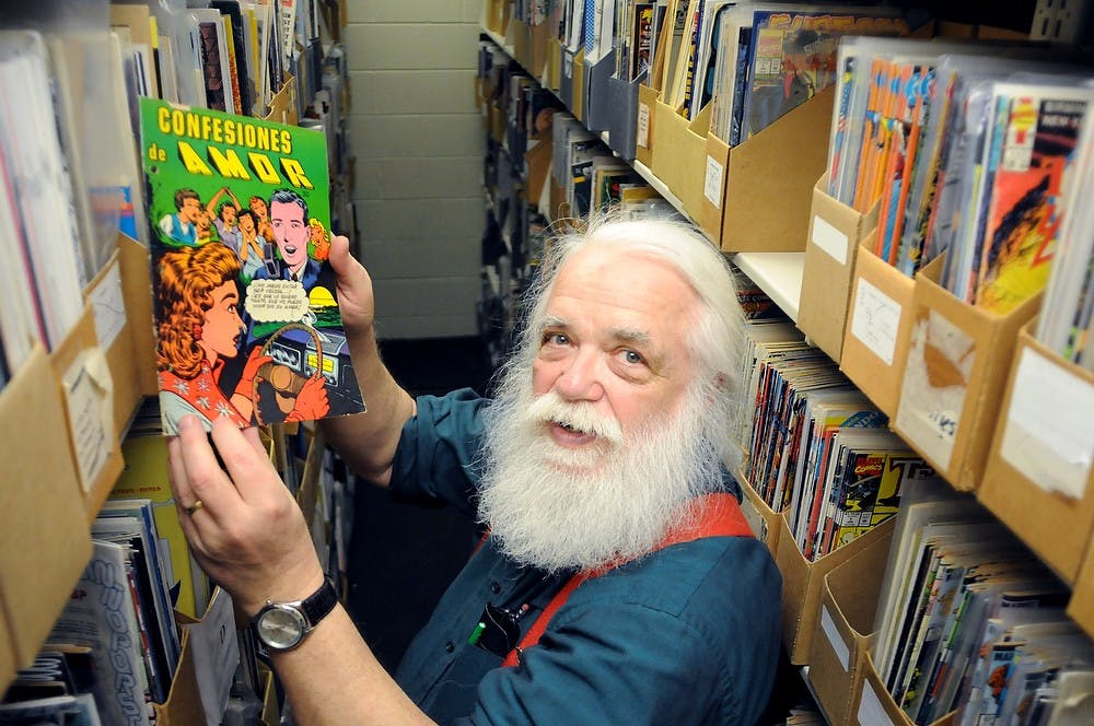 <p>Comic art bibliographer Randy Scott poses for a photo March 28, 2013 at the Main Library. The Main Library is home to the largest library collection of comic books in the world. Katie Stiefel/The State News</p>