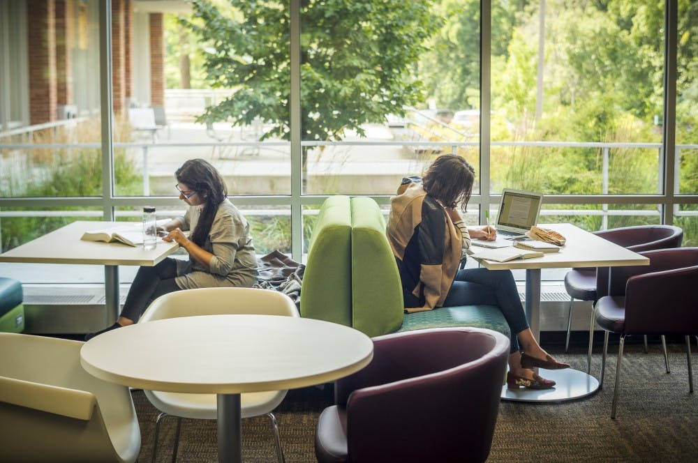 Students are pictured while studying on Aug 15 at the Main Library.