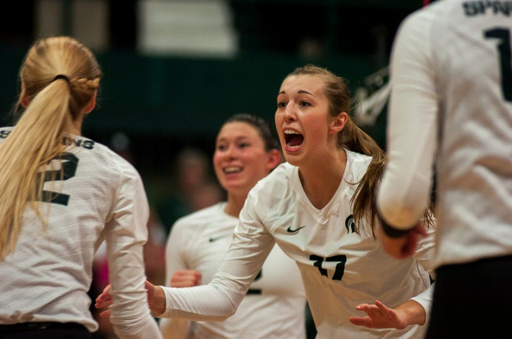 <p>&nbsp;Senior middle blocker Alyssa Garvelink (17) reacts to a play during the game against Wisconsin on Oct. 7, 2017 at Jenison Fieldhouse. The Spartans defeated the Badgers, 3-1. &nbsp;&nbsp;</p>