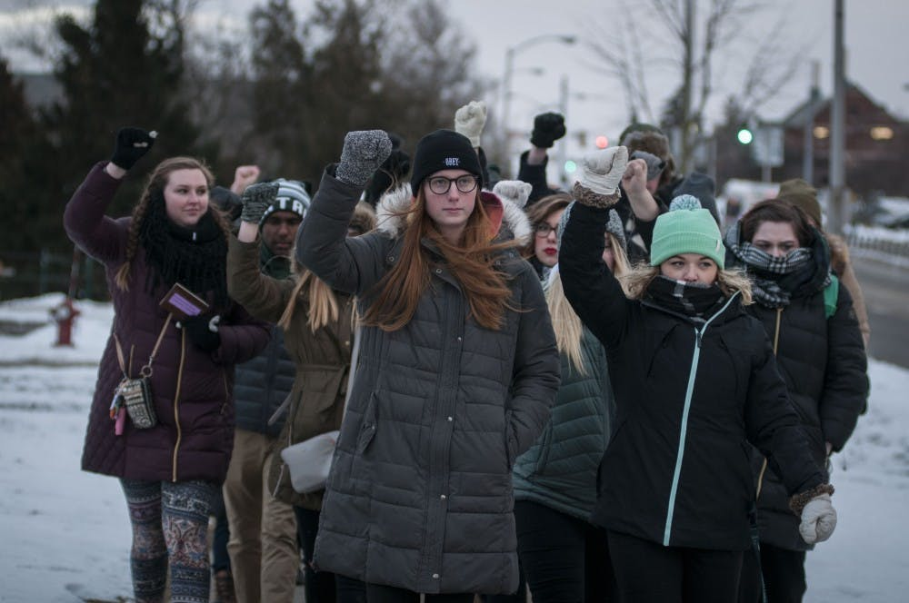 Protestors begin their trek to the Hannah Administration Building during the March for Transparency on Feb. 2, 2018, at Michigan State University's campus. (C.J. Weiss | The State News)