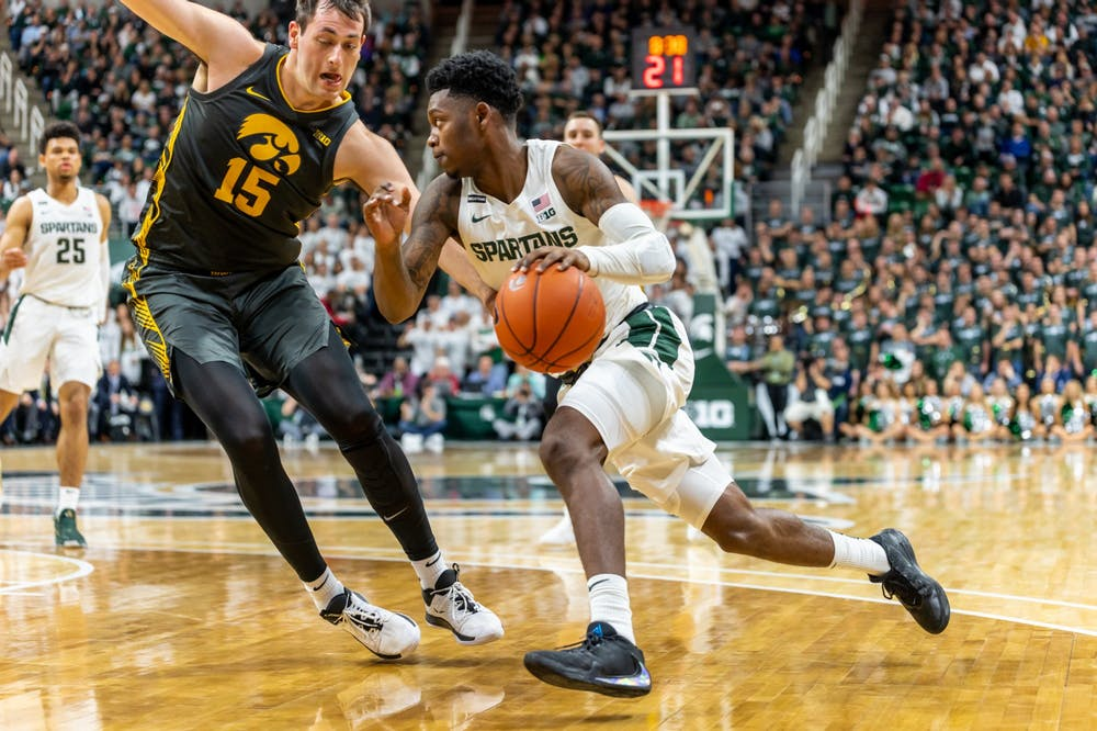 <p>Sophomore guard Rocket Watts (right) drives on Iowa forward Ryan Kriener (left). The Spartans defeated the Hawkeyes, 78-70, at the Breslin Student Events Center on Feb. 25, 2020. </p>