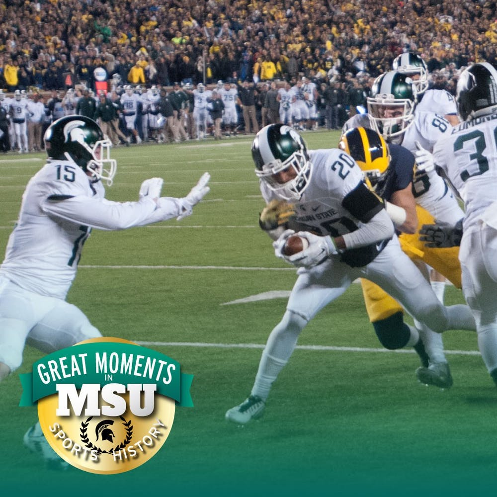 Former redshirt freshman defensive back Jalen Watts-Jackson runs the ball for the game-winning touchdown during the game against Michigan on Oct. 17, 2015 at Michigan Stadium. The Spartans defeated the Wolverines, 27-23. Photo by Joshua Abraham. Design by Daena Faustino.