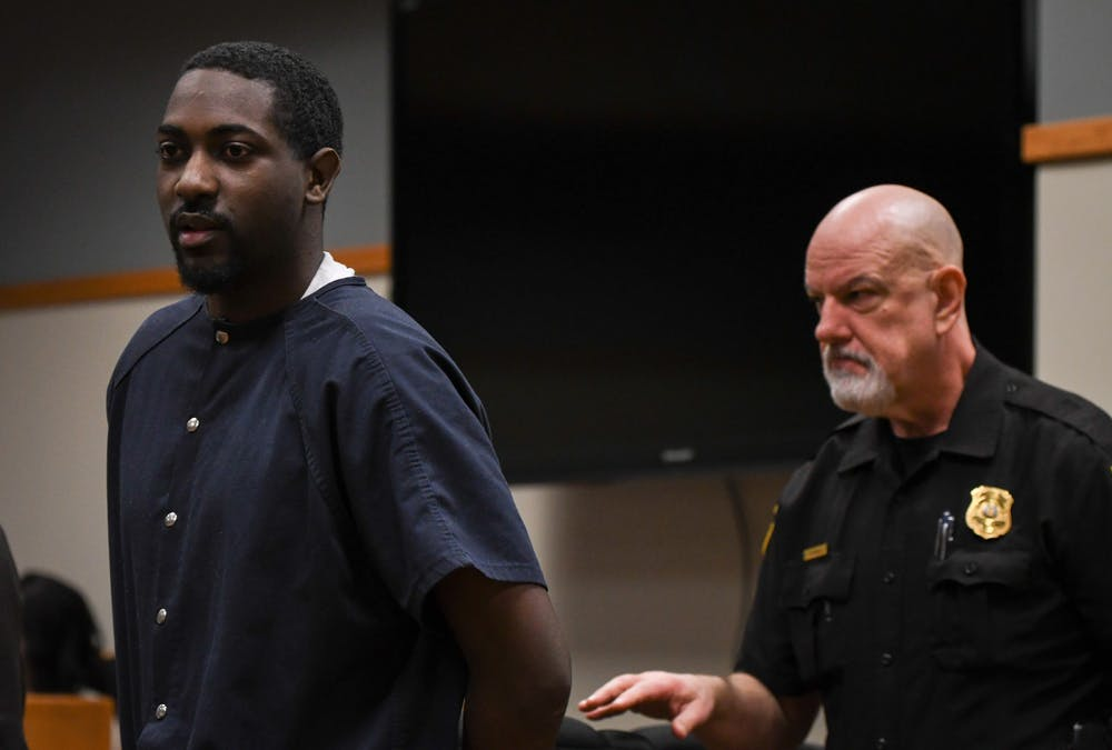 <p>22-year-old Najee Thompson is escorted out of the courtroom following his preliminary hearing in the 54B District Court on Feb. 6, 2020. </p>