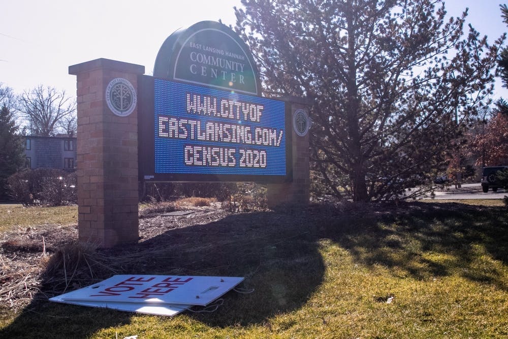 <p>A &quot;Vote Here&quot; sign sits on the ground in front of the Hannah Community Center sign during the election March 10, 2020.</p>