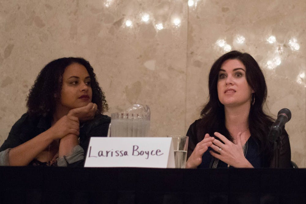 Executive Director of the Firecracker Foundation Tashmica Torok, left, listens to Nassar survivor Larissa Boyce on a panel about addressing red flags to identify sexual offenders at the MSU Union on Sept. 21, 2018.