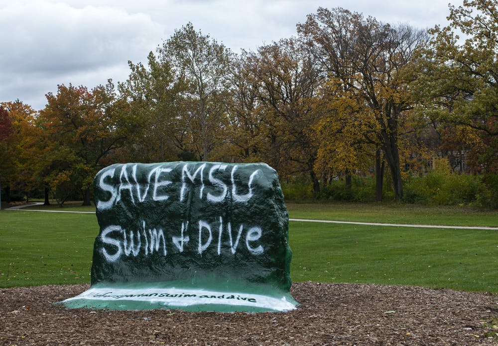 <p>The Rock on Farm Lane is painted to show support against cutting the MSU swim and dive program. The university declared on Thursday they would stop funding the program after the 2020-21 school year is over. Shot on Oct. 26, 2020. </p>