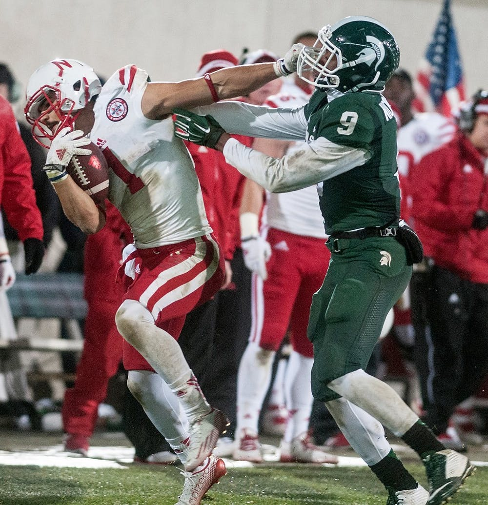 <p>Then-freshmen defensive back Montae Nicholson tackles then-Nebraska wide receiver Jordan Westerkamp Oct. 4, 2014, at Spartan Stadium. The Spartans defeated the Cornhuskers, 27-22. State News File Photo</p>