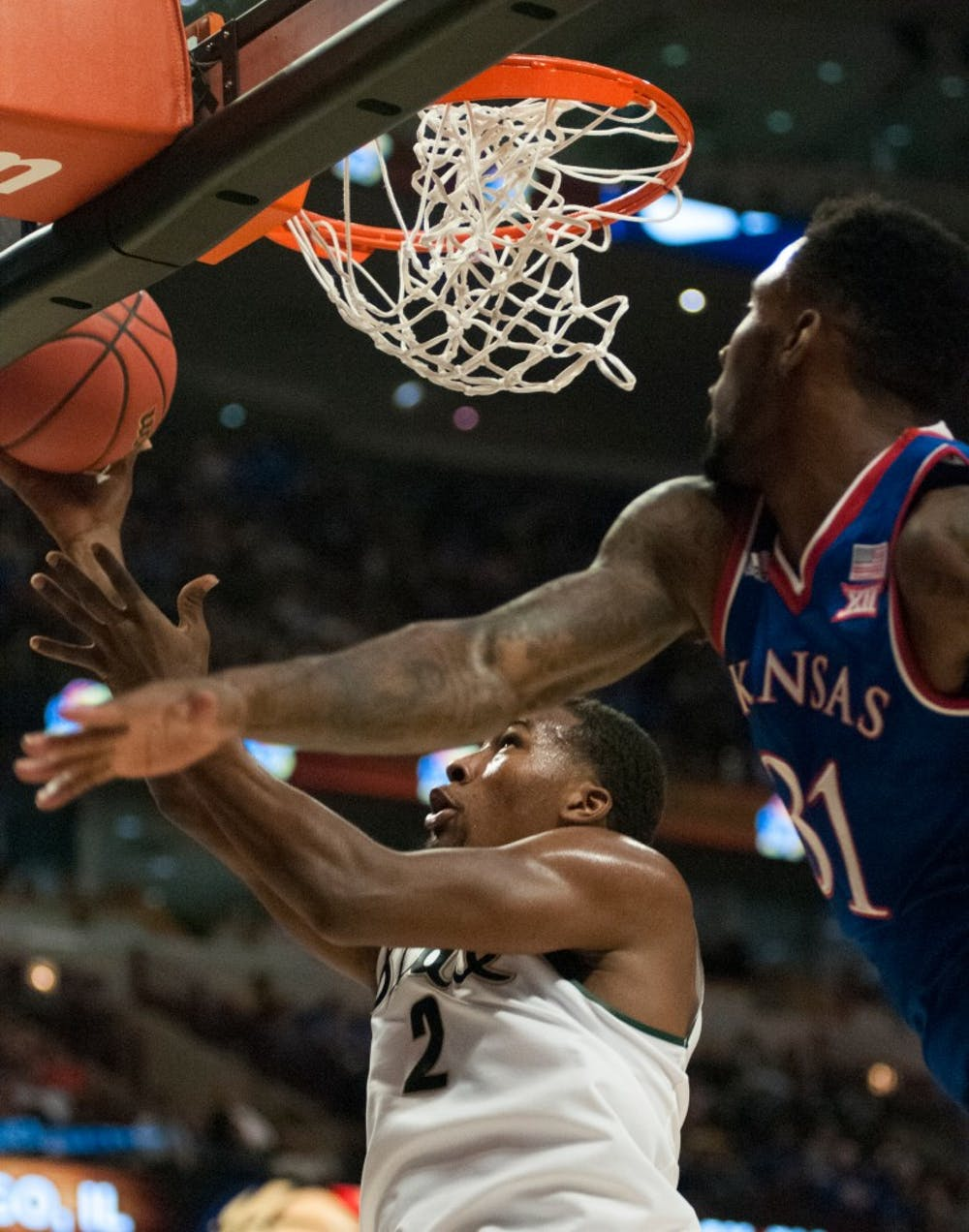 <p>Sophomore guard Javon Bess goes for the lay-up as Kansas forward Jamari Traylor defends on Nov. 17, 2015 at United Center in Chicago during the Champions Classic. The Spartans defeated the Jayhawks, 79-73.</p>