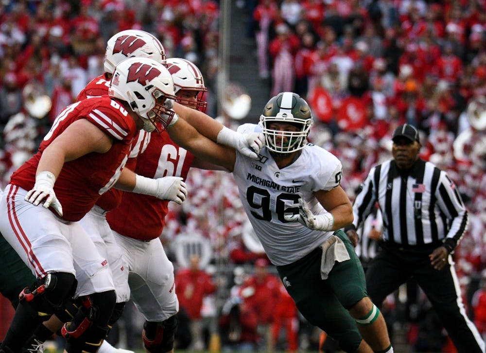 <p>Junior defensive end Jacub Panasiuk (96) pushes back Wisconsin players during the game against Wisconsin at Camp Randall Stadium on October 12, 2019. The Spartans lost to the Badgers 38-0. </p>