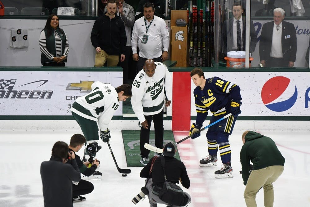 MSU head football coach Mel Tucker drops the puck before the game against Michigan on Feb. 14, 2020 at the Munn Ice Arena. MSU fell to U of M 5-1.