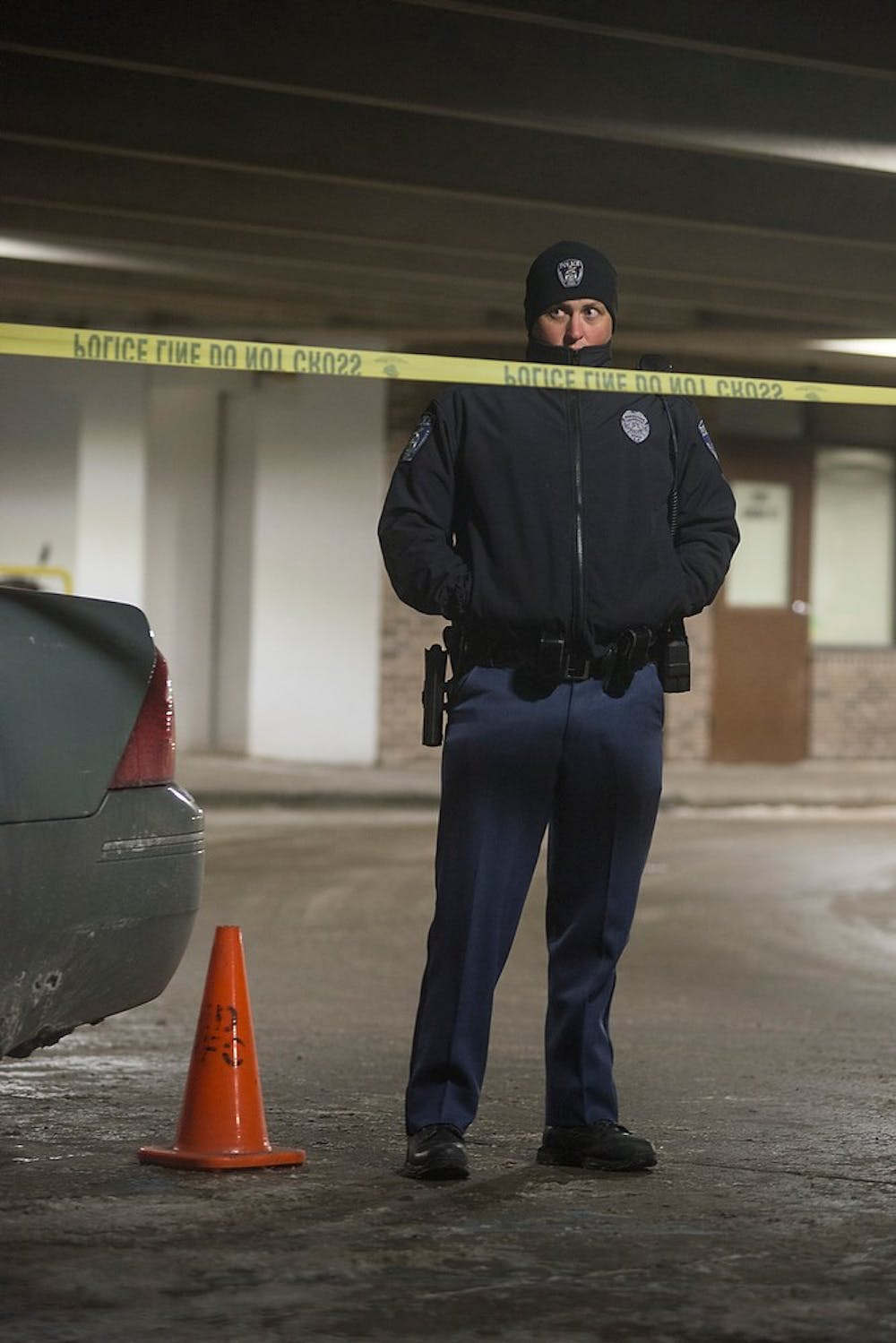 <p>Police units arrive at the scene on Feb. 6, 2015, at the Grove Ramp where a shooting occurred just after midnight. Police had cordoned off the ramp at all entrances, in addition to the entrance to the apartments next door. Emily Nagle/The State News</p>