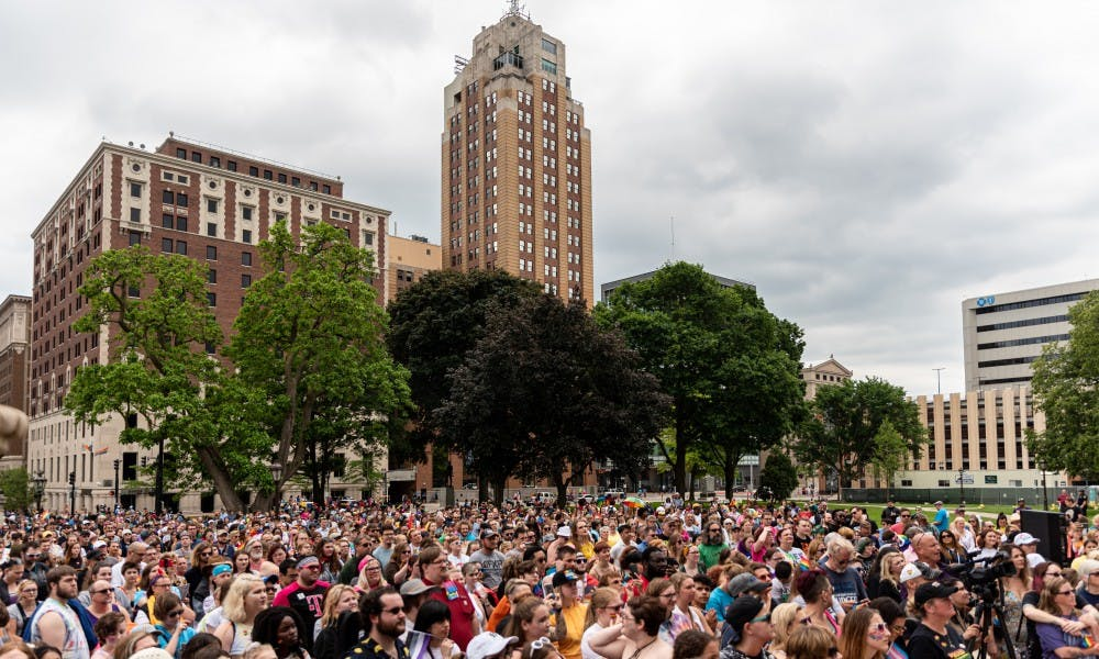 <p>A record crowd gathers outside of the Michigan Capitol for the 2019 Michigan Pride Rally on June 15, 2019.</p>