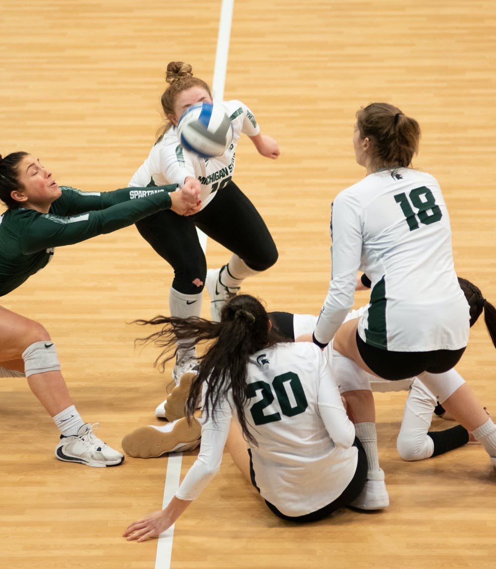 <p>Five of the Spartans dive for the ball during the Spartans&#x27; loss against the Wisconsin Badgers on Feb. 20, 2021.</p>