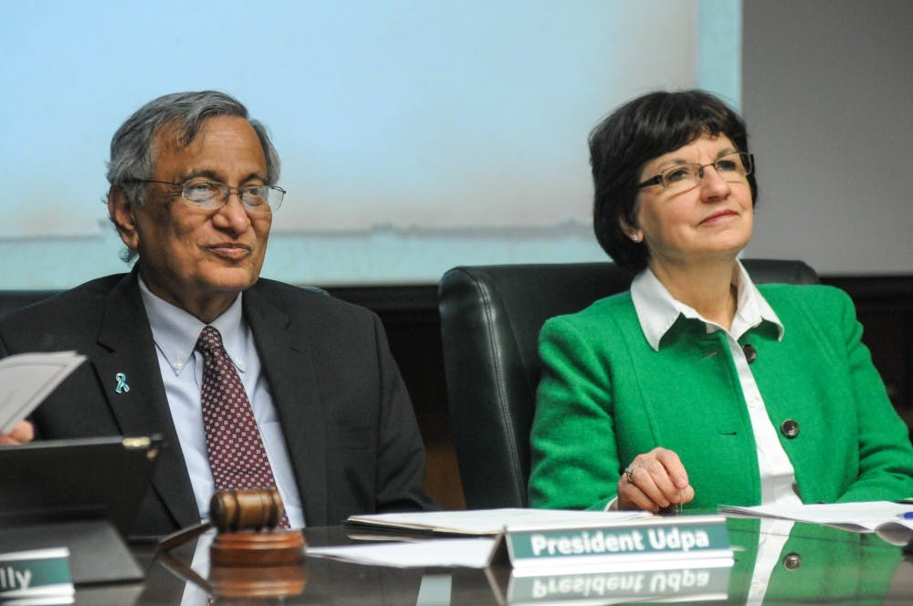 <p>Interim President Satish Udpa, left, and trustee Byrum, right, listen at the Board of Trustees meeting on April 12, 2019 at the Administration Building.</p>