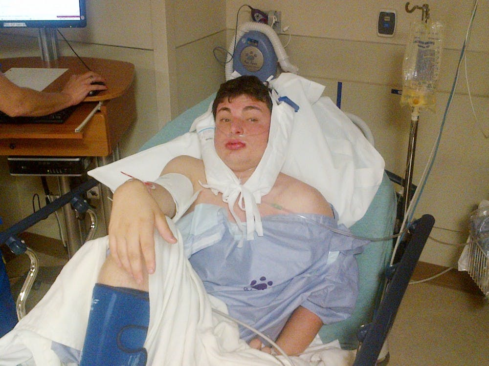 Journalism sophomore Zachary Tennen sits in his hospital bed on Monday afternoon, Aug. 27, 2012 in St. Joseph's Mercy Hospital in Pontiac, Mich. Early Sunday morning, Tennen was the victim of an assault he believed was a hate crime. Photograph courtesy of Tennen family.