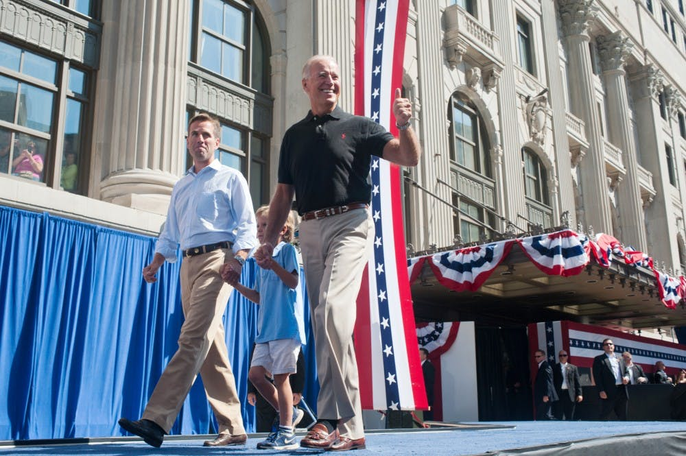 <p>Vice President Joe Biden, right, walks on stage with his grandson Hunter Biden, 6, center, and his son Beau Biden, left, attorney general of Delaware on Monday, Sept. 3, 2012 in downtown Detroit. Justin Wan/The State News</p>