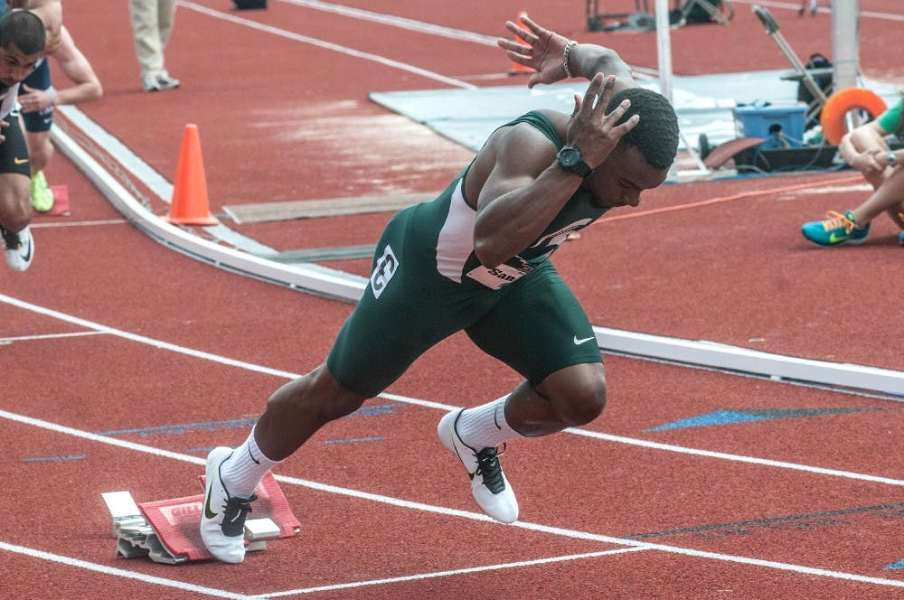 <p>Junior Austin Sanders competes in the 400 meter trials on May 16, 2015 at the 2015 Big Ten Track and Field Championships at Ralph Young Field in East Lansing, Mich. Ryan Squanda/The State News</p>