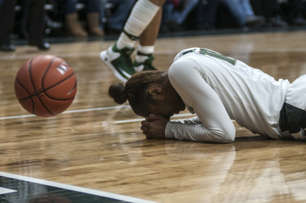 Senior guard Branndais Agee (10) lies on the court in frustration after she was whistled for a foul during the game against Notre Dame on Dec. 20, 2016 at Breslin Center. The Fighting Irish defeated the Spartans, 79-61.