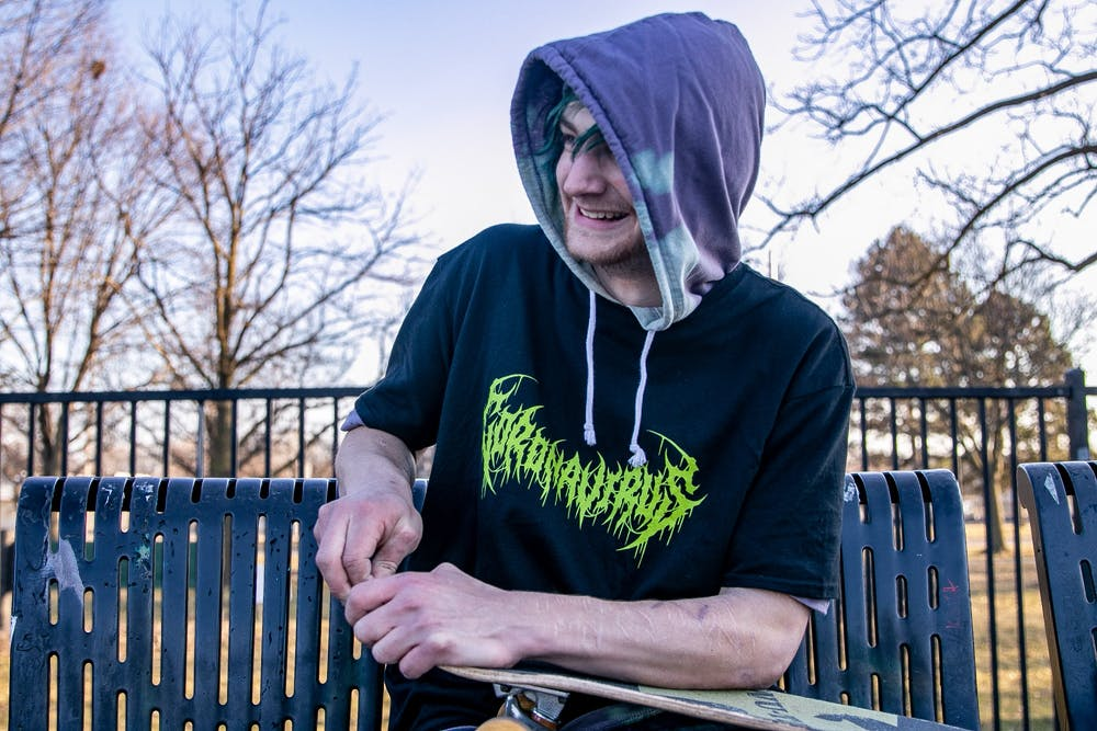 Collin Cummings plays with his skateboard on St. Patrick's Day 2020 in Frandor Skate Park despite the recent coronavirus outbreaks.