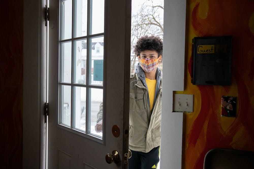 <p>Feb. 22- East Lansing- Each individual MSU SHC has their own COVID-19 expectations. Orion SHC members are allowed one guest for the duration of the semester and guests must wear a mask in all common spaces. Pictured here is guest of Orion SHC, Emerson Ganton, entering the house.</p>