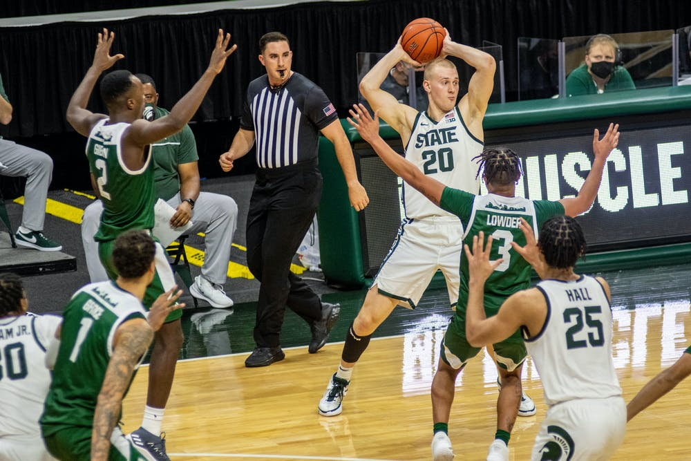 Red-shirt junior forward Joey Hauser(20) tries to pass the ball during the game against Eastern Michigan on Nov. 25, 2020 at the Breslin Center. The Spartans defeated the Eagles, 83-67.
