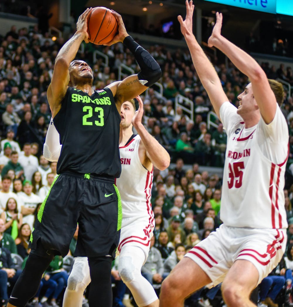 <p>Junior forward Xavier Tillman (23) shoots the ball during the game against Wisconsin on Jan. 17, 2020 at Breslin Center. The Spartans lead the Badgers at the half, 35-20.</p>