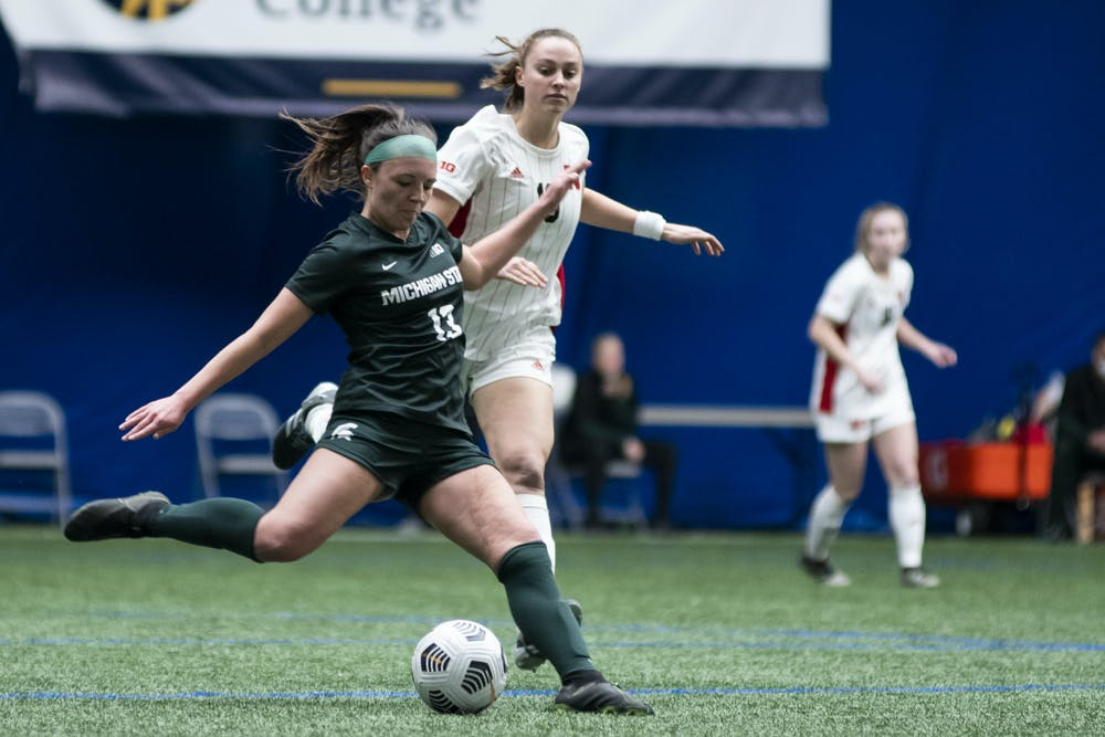 Senior defense Athena Biondi (13) kicks the ball during the game against Nebraska on February 25, 2021, at The St. Joe's Sports Dome. The Spartans defeated the Cornhuskers 2-0.