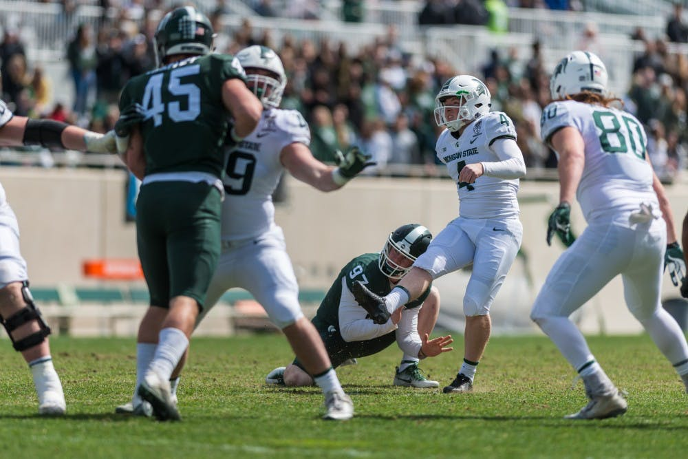 <p>Kicker Matt Coghlin (4) kicks an extra point. The green team beat the white team, 42-26, in the MSU spring football game on April 13, 2019 at Spartan Stadium.</p>